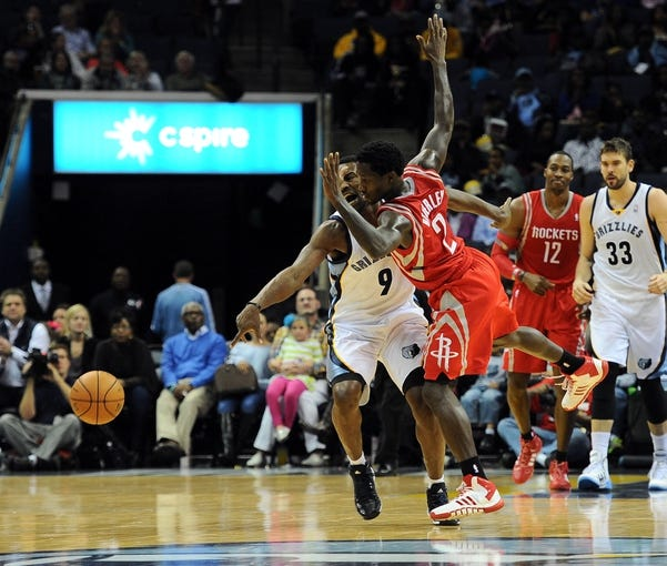 Oct 25, 2013; Memphis, TN, USA; Memphis Grizzlies shooting guard Tony Allen (9) is fouled by Houston Rockets point guard Patrick Beverley (2) during the second quarter at FedExForum. Mandatory Credit: Justin Ford-USA TODAY Sports