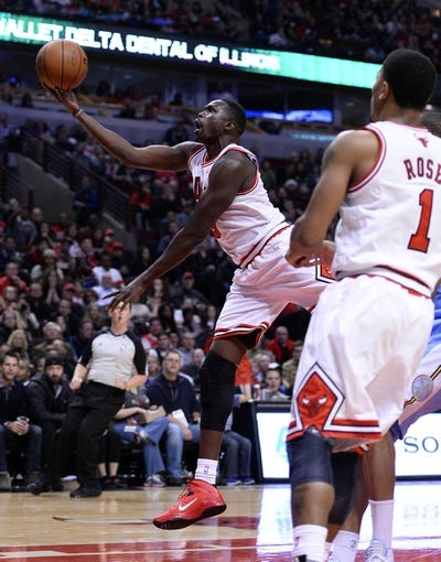 Oct 25, 2013; Chicago, IL, USA; Chicago Bulls small forward Luol Deng (9) shoots the ball against the Denver Nuggets during the second half at the United Center. Chicago defeats Denver 94-89. Mandatory Credit: Mike DiNovo-USA TODAY Sports