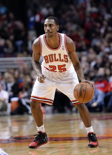 Oct 25, 2013; Chicago, IL, USA; Chicago Bulls point guard Marquis Teague (25) dribbles the ball against the Denver Nuggets during the second half at the United Center. Chicago defeats Denver 94-89. Mandatory Credit: Mike DiNovo-USA TODAY Sports