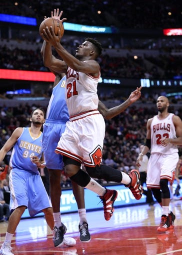 Oct 25, 2013; Chicago, IL, USA;  Chicago Bulls shooting guard Jimmy Butler (21) shoots the ball against the Denver Nuggets during the second half at the United Center. Chicago defeats Denver 94-89. Mandatory Credit: Mike DiNovo-USA TODAY Sports