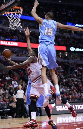 Oct 25, 2013; Chicago, IL, USA; Chicago Bulls shooting guard Jimmy Butler (21) shoots the ball against Denver Nuggets power forward Anthony Randolph (15) during the second half at the United Center. Chicago defeats Denver 94-89. Mandatory Credit: Mike DiNovo-USA TODAY Sports