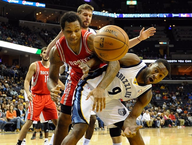 Oct 25, 2013; Memphis, TN, USA; Houston Rockets power forward Greg Smith (4) and Memphis Grizzlies shooting guard Tony Allen (9) fight for the ball during the third quarter at FedExForum. Memphis Grizzlies lose to Houston Rockets 92 - 73. Mandatory Credit: Justin Ford-USA TODAY Sports