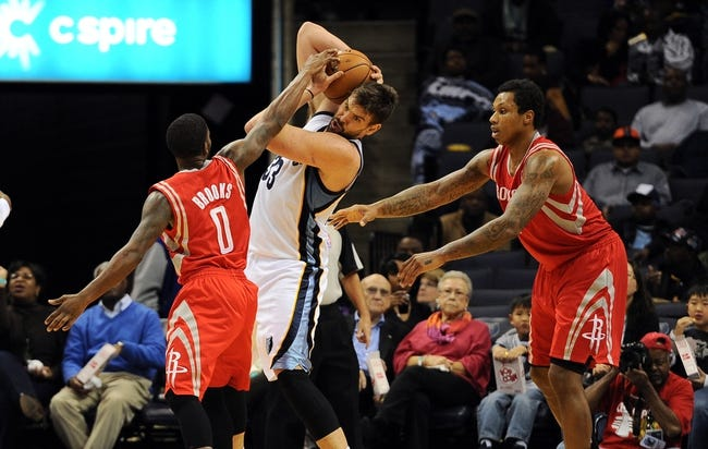 Oct 25, 2013; Memphis, TN, USA; Memphis Grizzlies center Marc Gasol (33) and Houston Rockets point guard Aaron Brooks (0) fight for the ball during the third quarter at FedExForum. Memphis Grizzlies lose to Houston Rockets 92 - 73. Mandatory Credit: Justin Ford-USA TODAY Sports