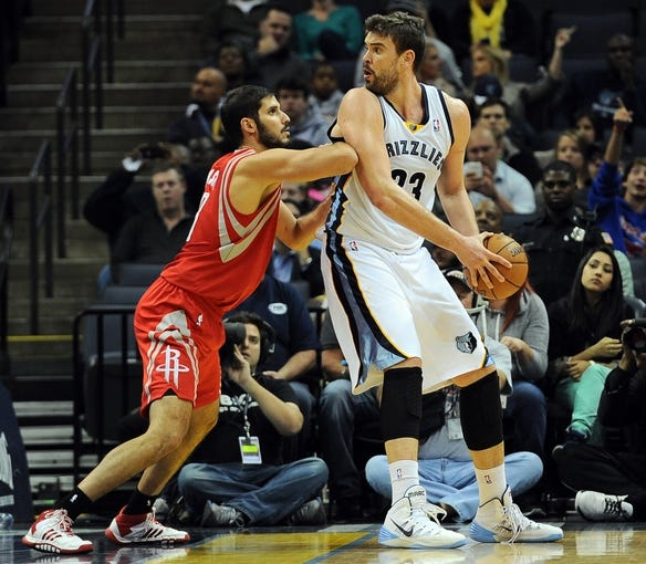 Oct 25, 2013; Memphis, TN, USA; Memphis Grizzlies center Marc Gasol (33) posts up against Houston Rockets small forward Omri Casspi (18) during the third quarter at FedExForum. Memphis Grizzlies lose to Houston Rockets 92 - 73. Mandatory Credit: Justin Ford-USA TODAY Sports