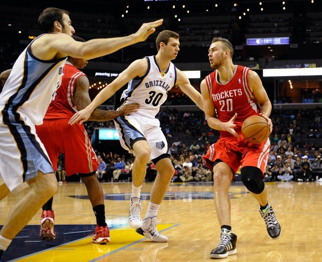 Oct 25, 2013; Memphis, TN, USA; Houston Rockets power forward Donatas Motiejunas (20) looks for a open player against Memphis Grizzlies during the fourth quarter at FedExForum. Memphis Grizzlies lose to Houston Rockets 92 - 73. Mandatory Credit: Justin Ford-USA TODAY Sports