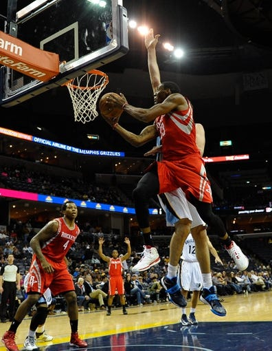 Oct 25, 2013; Memphis, TN, USA; Houston Rockets small forward Robert Covington (33) lays the ball up against the Memphis Grizzlies during the fourth quarter at FedExForum. Memphis Grizzlies lose to Houston Rockets 92 - 73. Mandatory Credit: Justin Ford-USA TODAY Sports