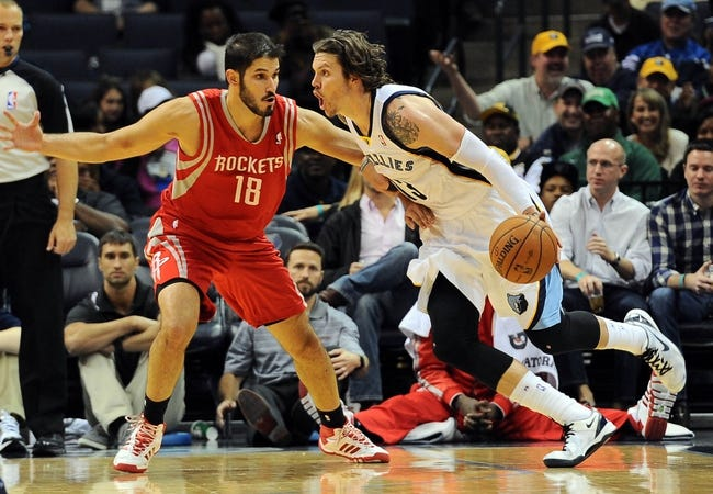 Oct 25, 2013; Memphis, TN, USA; Memphis Grizzlies small forward Mike Miller (13) handles the ball against Houston Rockets during the fourth quarter at FedExForum. Memphis Grizzlies lose to Houston Rockets 92 - 73. Mandatory Credit: Justin Ford-USA TODAY Sports