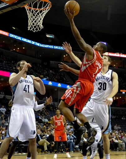 Oct 25, 2013; Memphis, TN, USA; Houston Rockets point guard Isaiah Canaan (1) lays the ball up against Memphis Grizzlies during the fourth quarter at FedExForum. Memphis Grizzlies lose to Houston Rockets 92 - 73. Mandatory Credit: Justin Ford-USA TODAY Sports