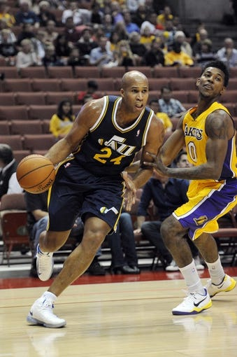 Oct 25, 2013; Anaheim, CA, USA; Utah Jazz forward Richard Jefferson (24) drives the ball while defended by Los Angeles Lakers guard Nick Young (0) during the first quarter at Honda Center. Mandatory Credit: Kelvin Kuo-USA TODAY Sports