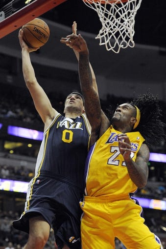 Oct 25, 2013; Anaheim, CA, USA; Utah Jazz center Enes Kanter (0) goes up for a shot while defended by Los Angeles Lakers center Jordan Hill (27) during the second quarter at Honda Center. Mandatory Credit: Kelvin Kuo-USA TODAY Sports