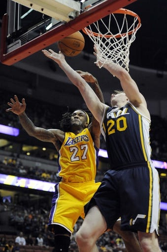 Oct 25, 2013; Anaheim, CA, USA; Utah Jazz forward Gordon Hayward (20) goes up for a shot while defended by Los Angeles Lakers center Jordan Hill (27) during the second quarter at Honda Center. Mandatory Credit: Kelvin Kuo-USA TODAY Sports