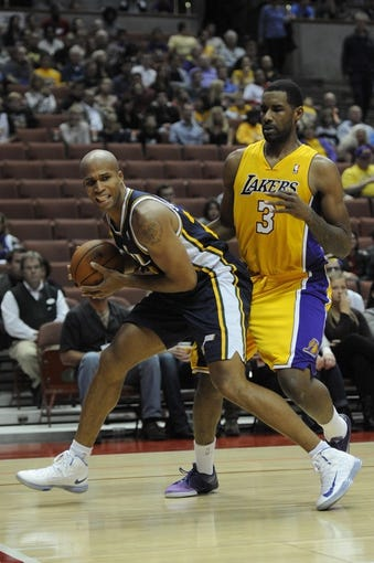 Oct 25, 2013; Anaheim, CA, USA; Utah Jazz forward Richard Jefferson (24) handles the ball while defended by Los Angeles Lakers forward Shawne Williams (3) during the second quarter at Honda Center. Mandatory Credit: Kelvin Kuo-USA TODAY Sports