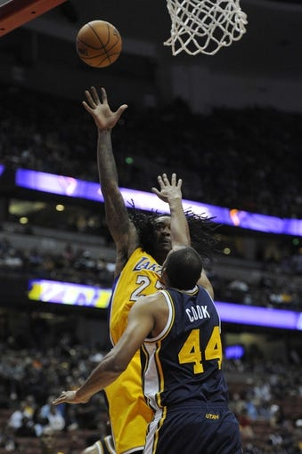 Oct 25, 2013; Anaheim, CA, USA; Los Angeles Lakers center Jordan Hill (27) goes up for a shot while defended by Utah Jazz forward Brian Cook (44) during the fourth quarter at Honda Center. The Los Angeles Lakers defeated the Utah Jazz 111-106. Mandatory Credit: Kelvin Kuo-USA TODAY Sports