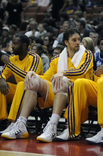 Oct 25, 2013; Anaheim, CA, USA; Los Angeles Lakers forward Pau Gasol (16) sits on the bench during the game against the Utah Jazz during the fourth quarter at Honda Center. The Los Angeles Lakers defeated the Utah Jazz 111-106. Mandatory Credit: Kelvin Kuo-USA TODAY Sports