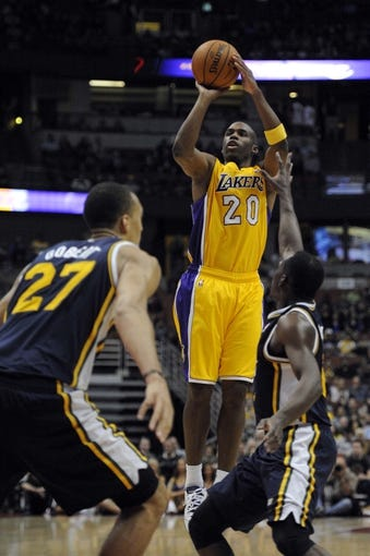Oct 25, 2013; Anaheim, CA, USA; Los Angeles Lakers guard Jodie Meeks (20) goes up for a shot against the Utah Jazz during the fourth quarter at Honda Center. The Los Angeles Lakers defeated the Utah Jazz 111-106. Mandatory Credit: Kelvin Kuo-USA TODAY Sports