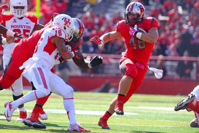 Oct 26, 2013; Piscataway, NJ, USA; Rutgers Scarlet Knights fullback Michael Burton (46) runs with the ball while being pursued by Houston Cougars defensive back Adrian McDonald (16) during the first half of their game against the Houston Cougars at High Point Solutions Stadium. Mandatory Credit: Ed Mulholland-USA TODAY Sports
