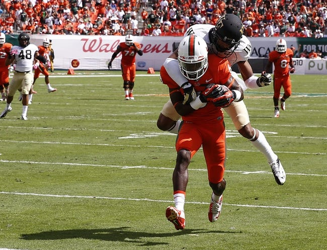 Oct 26, 2013; Miami Gardens, FL, USA; Miami Hurricanes wide receiver Herb Waters (6) catches a touchdown pass over Wake Forest Demon Deacons cornerback Kevin Johnson (9) in the second quarter at Sun Life Stadium. Mandatory Credit: Robert Mayer-USA TODAY Sports