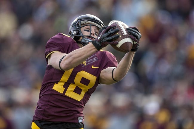 Oct 26, 2013; Minneapolis, MN, USA; Minnesota Golden Gophers wide receiver Derrick Engel (18) catches a touchdown in the second quarter against the Nebraska Cornhuskers at TCF Bank Stadium. Mandatory Credit: Jesse Johnson-USA TODAY Sports