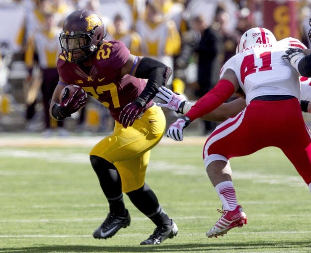Oct 26, 2013; Minneapolis, MN, USA; Minnesota Golden Gophers running back David Cobb (27) rushes with the ball in the second quarter against the Nebraska Cornhuskers at TCF Bank Stadium. Mandatory Credit: Jesse Johnson-USA TODAY Sports