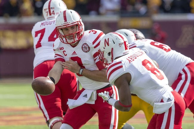 Oct 26, 2013; Minneapolis, MN, USA; Nebraska Cornhuskers quarterback Taylor Martinez (3) hands the ball off to running back Ameer Abdullah (8) in the second quarter against the Minnesota Golden Gophers at TCF Bank Stadium. Mandatory Credit: Jesse Johnson-USA TODAY Sports
