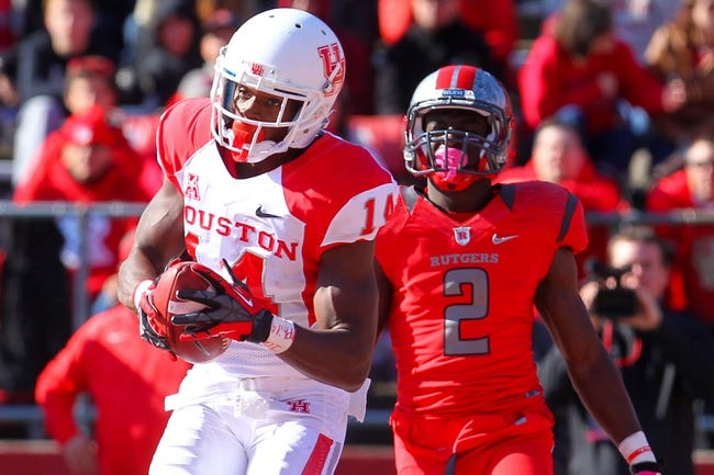 Oct 26, 2013; Piscataway, NJ, USA; Houston Cougars wide receiver Aaron Johnson (14) catches a touchdown pass during the second half of their game against the Rutgers Scarlet Knights at High Point Solutions Stadium. Mandatory Credit: Ed Mulholland-USA TODAY Sports