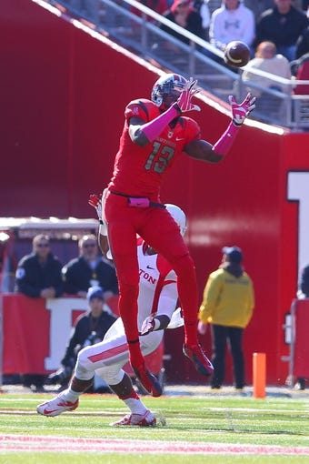 Oct 26, 2013; Piscataway, NJ, USA; Rutgers Scarlet Knights wide receiver Carlton Agudosi (13) catches a pass during the second half of their game against the Houston Cougars at High Point Solutions Stadium. Mandatory Credit: Ed Mulholland-USA TODAY Sports