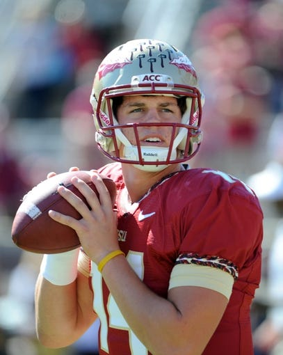 Oct 26, 2013; Tallahassee, FL, USA; Florida State Seminoles quarterback Jacob Coker (14) warms up before the start of the game against the North Carolina State Wolfpack at Doak Campbell Stadium. Mandatory Credit: Melina Vastola-USA TODAY Sports