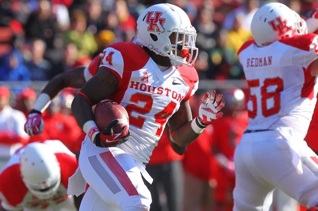 Oct 26, 2013; Piscataway, NJ, USA; Houston Cougars running back Kent Brooks (24) runs with the ball during the second half of their game against the Rutgers Scarlet Knights at High Point Solutions Stadium. Houston defeated Rutgers 49-14.  Mandatory Credit: Ed Mulholland-USA TODAY Sports