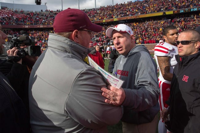 Oct 26, 2013; Minneapolis, MN, USA; Minnesota Golden Gophers acting head coach Tracy Claeys meets with Nebraska Cornhuskers head coach Bo Pelini after the game at TCF Bank Stadium. The Gophers won 34-23. Mandatory Credit: Jesse Johnson-USA TODAY Sports