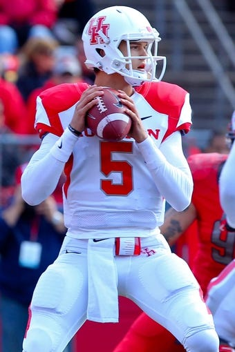 Oct 26, 2013; Piscataway, NJ, USA; Houston Cougars quarterback John O'Korn (5) looks to pass during the first half of their game against the Rutgers Scarlet Knights at High Point Solutions Stadium. Mandatory Credit: Ed Mulholland-USA TODAY Sports
