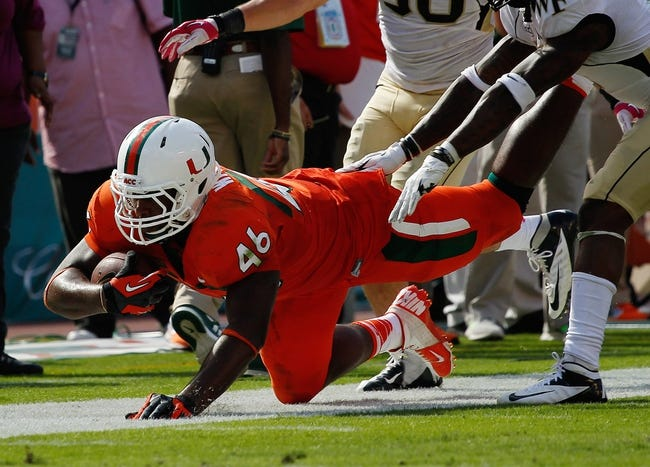 Oct 26, 2013; Miami Gardens, FL, USA; Miami Hurricanes tight end Clive Walford (46) catches a pass against the Wake Forest Demon Deacons in the second half at Sun Life Stadium. Miami won 24-21. Mandatory Credit: Robert Mayer-USA TODAY Sports