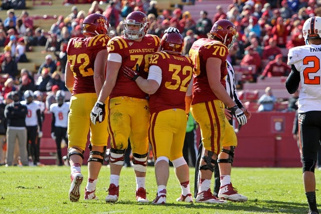 Oct 26, 2013; Ames, IA, USA; Iowa State Cyclones running back Jeff Woody (32) celebrates his touchdown with Iowa State Cyclones offensive lineman Jamison Lalk (76) during the fourth quarter against the Oklahoma State Cowboys at Jack Trice Stadium. Oklahoma State defeated Iowa State 58-27. Mandatory Credit: Brace Hemmelgarn-USA TODAY Sports