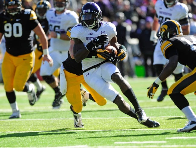 Oct 26, 2013; Iowa City, IA, USA; Northwestern Wildcats wide receiver Rashad Lawrence (17) is tackled by Iowa Hawkeye linebacker Marcus Collins (55) during the third quarter at Kinnick Stadium. Mandatory Credit: Byron Hetzler-USA TODAY Sports