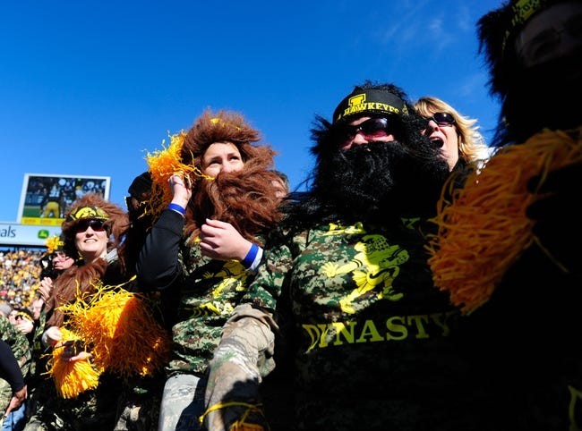 """Oct 26, 2013; Iowa City, IA, USA; Iowa Hawkeyes fans dressed up as """"Hawk Dynasty"""" characters during game against the Nothwestern Wildcats at Kinnick Stadium. Mandatory Credit: Byron Hetzler-USA TODAY Sports"""