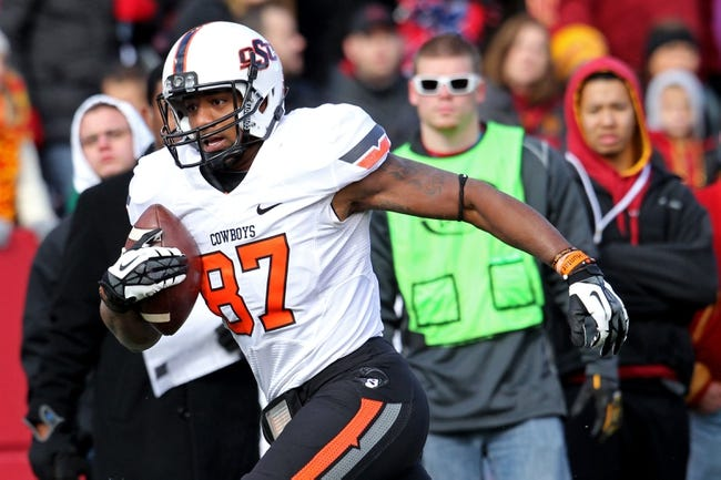 Oct 26, 2013; Ames, IA, USA; Oklahoma State Cowboys wide receiver Tracy Moore (87) carries the ball during the first quarter against the Iowa State Cyclones at Jack Trice Stadium. Oklahoma State defeated Iowa State 58-27. Mandatory Credit: Brace Hemmelgarn-USA TODAY Sports