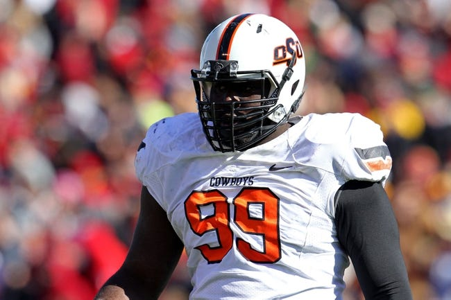 Oct 26, 2013; Ames, IA, USA; Oklahoma State Cowboys defensive tackle Calvin Barnett (99) looks on during the first quarter against the Iowa State Cyclones at Jack Trice Stadium. Oklahoma State defeated Iowa State 58-27. Mandatory Credit: Brace Hemmelgarn-USA TODAY Sports