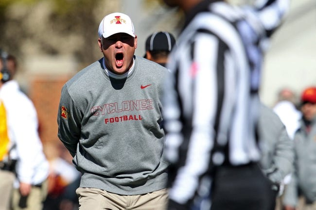 Oct 26, 2013; Ames, IA, USA; Iowa State Cyclones head coach Paul Rhoads argues a call during the second quarter against the Oklahoma State Cowboys at Jack Trice Stadium. Oklahoma State defeated Iowa State 58-27. Mandatory Credit: Brace Hemmelgarn-USA TODAY Sports