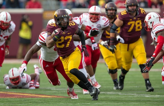 Oct 26, 2013; Minneapolis, MN, USA; Minnesota Golden Gophers running back David Cobb (27) rushes with the ball in the second half against the Nebraska Cornhuskers at TCF Bank Stadium. The Gophers won 34-23. Mandatory Credit: Jesse Johnson-USA TODAY Sports