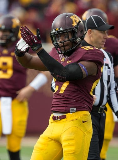 Oct 26, 2013; Minneapolis, MN, USA; Minnesota Golden Gophers running back David Cobb (27) celebrates after rushing for a first down in the second half against the Nebraska Cornhuskers at TCF Bank Stadium. The Gophers won 34-23. Mandatory Credit: Jesse Johnson-USA TODAY Sports