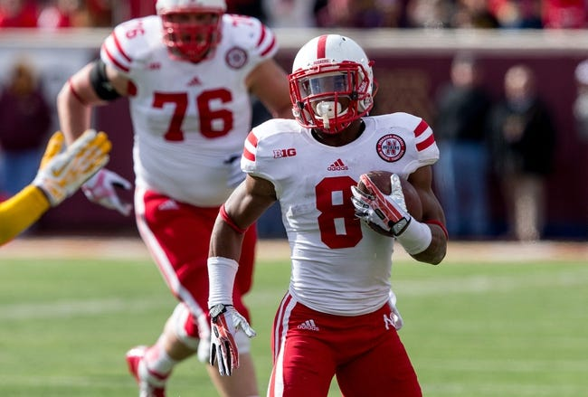 Oct 26, 2013; Minneapolis, MN, USA; Nebraska Cornhuskers running back Ameer Abdullah (8) rushes with the ball in the second half against the Minnesota Golden Gophers at TCF Bank Stadium. The Gophers won 34-23. Mandatory Credit: Jesse Johnson-USA TODAY Sports