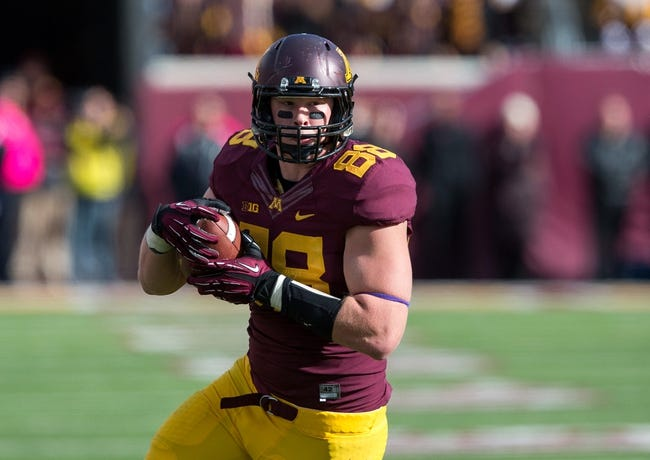 Oct 26, 2013; Minneapolis, MN, USA; Minnesota Golden Gophers tight end Maxx Williams (88) runs with the ball after making a catch in the second half against the Nebraska Cornhuskers at TCF Bank Stadium. The Gophers won 34-23. Mandatory Credit: Jesse Johnson-USA TODAY Sports