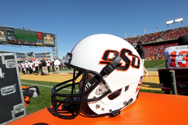 Oct 26, 2013; Ames, IA, USA; An Oklahoma State Cowboys helmet on the sidelines during the third quarter against the Iowa State Cyclones at Jack Trice Stadium. Oklahoma State defeated Iowa State 58-27. Mandatory Credit: Brace Hemmelgarn-USA TODAY Sports