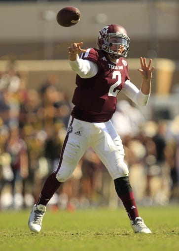 Oct 26, 2013; College Station, TX, USA; Texas A&M Aggies quarterback Johnny Manziel (2) passes against the Vanderbilt Commodores during the second half at Kyle Field. Texas A&M won 56-24. Mandatory Credit: Thomas Campbell-USA TODAY Sports