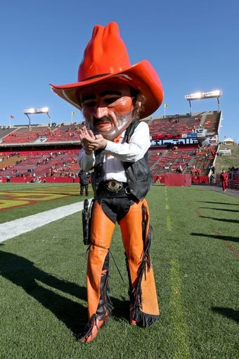 Oct 26, 2013; Ames, IA, USA; Oklahoma State Cowboys mascot, Pistol Pete, celebrates following the game against the Iowa State Cyclones at Jack Trice Stadium. Oklahoma State defeated Iowa State 58-27. Mandatory Credit: Brace Hemmelgarn-USA TODAY Sports