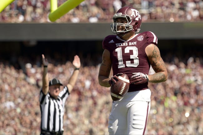 Oct 26, 2013; College Station, TX, USA; Texas A&M Aggies wide receiver Mike Evans (13) celebrates scoring a touchdown against the Vanderbilt Commodores during the second half at Kyle Field. Texas A&M won 56-24. Mandatory Credit: Thomas Campbell-USA TODAY Sports