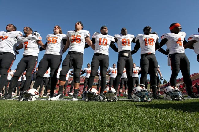Oct 26, 2013; Ames, IA, USA; The Oklahoma State Cowboys celebrate following the game against the Iowa State Cyclones at Jack Trice Stadium. Oklahoma State defeated Iowa State 58-27. Mandatory Credit: Brace Hemmelgarn-USA TODAY Sports
