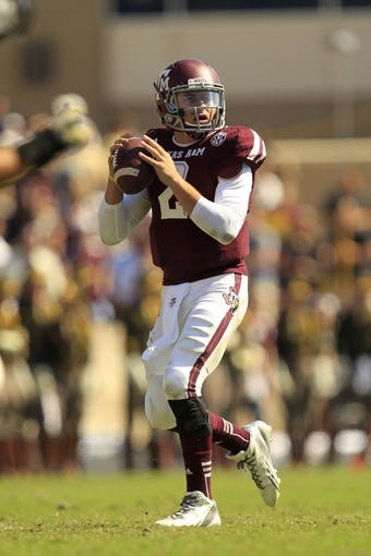 Oct 26, 2013; College Station, TX, USA; Texas A&M Aggies quarterback Johnny Manziel (2) drops back to pass against the Vanderbilt Commodores during the second half at Kyle Field. Texas A&M won 56-24. Mandatory Credit: Thomas Campbell-USA TODAY Sports