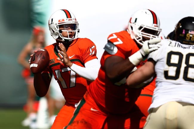 Oct 26, 2013; Miami Gardens, FL, USA; Miami Hurricanes quarterback Stephen Morris (17) drops back to pass in the second half of a game against the Wake Forest Demon Deacons at Sun Life Stadium. Miami won 24-21. Mandatory Credit: Robert Mayer-USA TODAY Sports