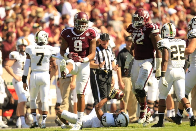Oct 26, 2013; College Station, TX, USA; Texas A&M Aggies linebacker Nate Askew (9) celebrates intercepting a pass against the Vanderbilt Commodores during the second half at Kyle Field. Texas A&M won 56-24. Mandatory Credit: Thomas Campbell-USA TODAY Sports