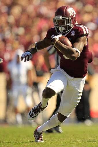 Oct 26, 2013; College Station, TX, USA; Texas A&M Aggies running back Brandon Williams (5) rushes against the Vanderbilt Commodores during the second half at Kyle Field. Texas A&M won 56-24. Mandatory Credit: Thomas Campbell-USA TODAY Sports